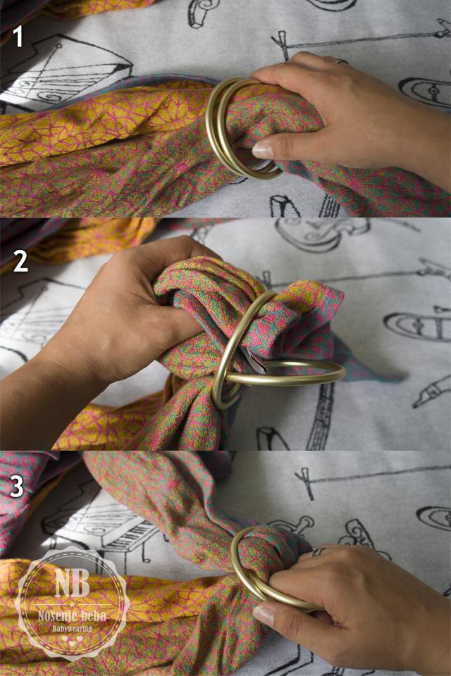 Razrađivanje tkane marame provlačenjem kroz prstene za nošenje.