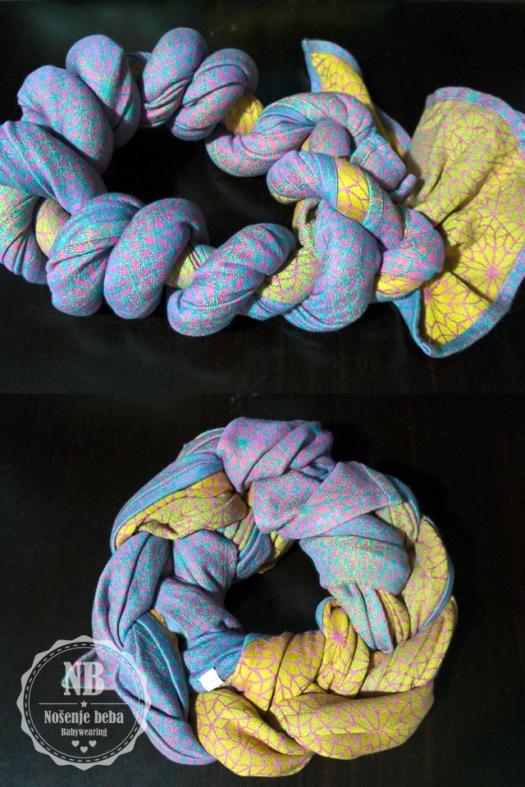 Lomljenje tkane marame za nošenje beba pletenjem i uvijanjem.