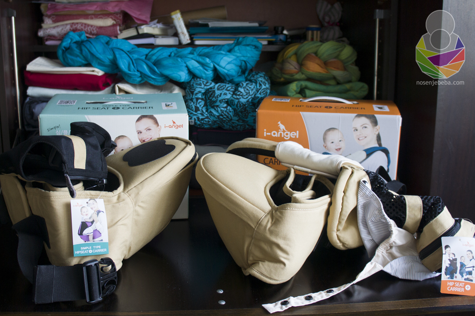 Vidljiva je razlika u dimenzijama između 2 modela I-Angel Hip Seat nosiljki. Lijevo: I-Angel SIMPLE Hip Seat Carrier. Desno: I-Angel MESH Hip Seat Baby Carrier.